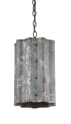 Who knew industrial machinery could look so good? The wavy Galvanized sheet metal that forms the body of the Frontier Pendant gives this fixture a truly distinctive feel. Old Iron chains complete the