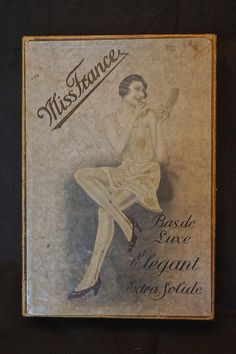 Antique French Stocking Box Miss France Vintage by snapitupvintage  Sometimes it's another woman's advertising....in this incidense  It's hosiery.  I really love the design of her hose.