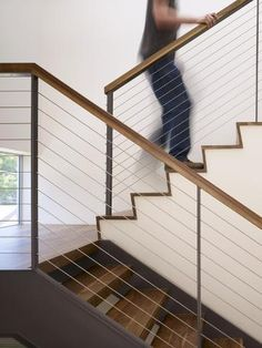size: Photo: Man Walking Up Stairs in Apartment by John Edward Linden : Painted Stair Railings, Cable Stair Railing, Metal Stairs, Staircase Railings, Modern Stairs, Painted Stairs, Modern Stair Railing, Staircase Ideas, Railing Design