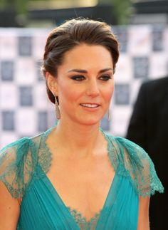 Kate Middleton wore her hair in a rare updo (she always has it down!) for an Olympics gala. eSalon.com