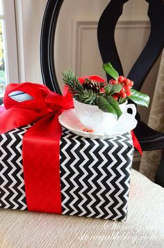 Holiday gifting vignette!!! Bebe'!!! Love the black chevron print on white with a touch of red!!!