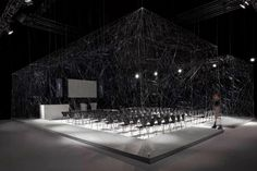 """Paul Cocksedge's """"Auditorium"""", in London, is veiled by hand-woven spider webs"""