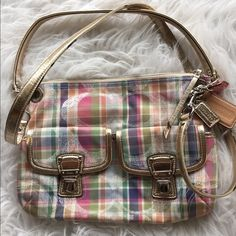 Coach Madras bag this bag is sooo cute! It's barely been used and has lots of life left. I love the glittery plaid pattern! NO TRADES DONT ASK! ✌️Transactions through posh only!   friendly home  if you ask a question about an item, please be ready to purchase (serious buyers only) ❤️Color may vary in person! ⭐️Bundles of 5+ LISTINGS are 5️⃣0️⃣% off! ⭐️buyer pays extra shipping if likely to be over 5 lbs thanks for looking! Coach Bags Shoulder Bags