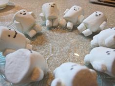 "The Adipose Marshmallows (large marshmallow with gel icing face, small marshmallow hands and feet ""glued"" on with a mixture of confectioners sugar and water). For my Doctor Who themed Masquerade birthday party."
