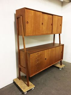 Great teak Highboard / Sideboard by Gunni Omann, Modell 3, from 1955, Denmark, Mid-Century, Vintage by ScandinavianLove on Etsy
