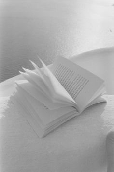 Pages rustling in the crisp Santorini morning winds whispering secrets among its lines that only its own reader can hear ( photo by William Abranowicz )