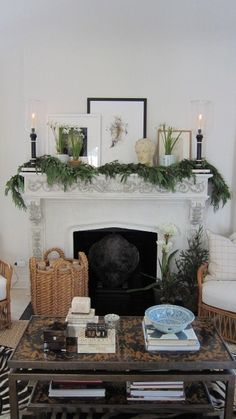 Gorgeous Living Room & Fireplace mantel...love the Decor on the Mantel & the beautiful pine garland intertwined on the mantel for the Christmas Holidays & the tiny pine tree on the hearth. December 2011 issue of House Beautiful, designed by Mark D. Sikes