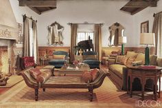 A Beverly Hills living room designed by Madeline Stuart includes a 19th-century Anglo-Indian daybed with cushions made from vintage saris, mirrors based on Indian motifs, and a copper elephant from JF Chen.  William Waldron  - ELLEDecor.com