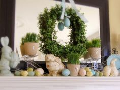 Blogger Kerri-Lynn Roche uses vintage bunny figurines, a boxwood wreath, painted eggs and potted grass to create a soft and subtle Easter look on her mantel. A large mirror and glass candleholders add shimmer and are a great contrast to all the natural elements. Photo courtesy of Kerri-Lynn Roche
