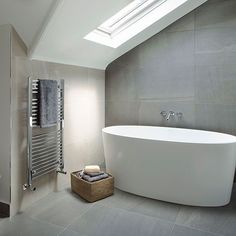 Grey and stone modern bathroom | contemporary free standing bath tub || Decorating | http://housetohome.co.uk