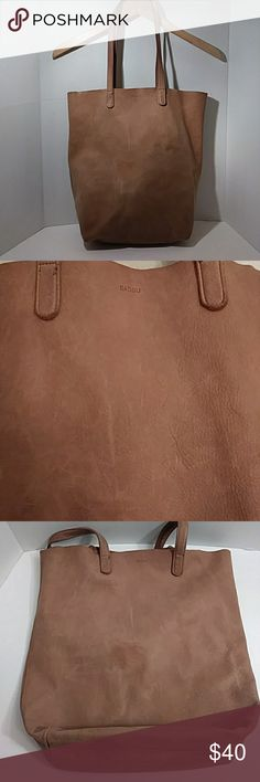 "Anthropologie Baggu tan leather tote Very soft large leather tote in good condition, there's some light spots on the bag, not very noticable it blends in with the color, view pictures please.13"" tall, 14.5"" across, 10.5"" strap drop Anthropologie Bags Totes"