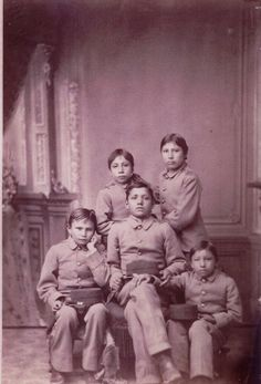 """Native children during this period were taken from their homes, families, and reservations and shipped over vast distances to the boarding schools. Attendance at such schools was required of all Native children between the ages of 10-18. Children were shorn of their identities in every way, including name, style of dress, and even personal appearance... Students were... taught that they were inferior, and that the school was there to """"raise them up"""" from savagery to the level of non-Natives."""