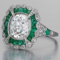 Art Deco Ring Diamond and Emerald Ring . This ring is stunning!