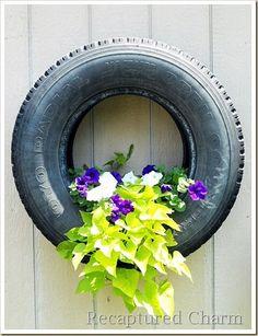 new craze old tire planters, gardening, repurposing upcycling, Via Old Tire Planters, Diy Planters, Planters Flowers, Flowers Garden, Plants For Hanging Baskets, Plant Basket, Plant Pots, Old Tires, Diy Hanging