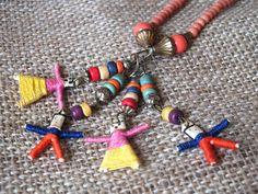 Vintage Rainbow Beaded Boho Necklace With Miniature Figurines. $12.00, via Etsy.