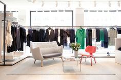 COS store - Compared to H&M this sub-brand is remarkably close to the likes of Acne Studios or Filippa K, showing us the good quality and minimal design from Scandinavia Cos Stores, Shops, Retail Merchandising, Interior Decorating, Interior Design, Retail Space, Shop Interiors, Minimal Design, Danish Design