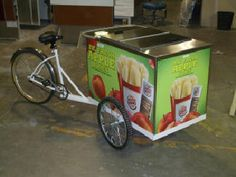 ICE Cream Tricycle with hold over plates by Industrialbicycles.com Phone 800 561-6670 Keeps Ice Cream Cold for up to 10 Hours then just plug in overnight to recharge.