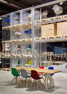 schemata architects builds vitra s salone stand from wooden pallets