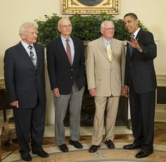 President Barack Obama poses with Apollo 11 astronauts, from left, Buzz Aldrin, Michael Collins, and Neil Armstrong, Monday, July 20, 2009, in the Oval Office of the White House in Washington, on the 40th anniversary of the Apollo 11 lunar landing.