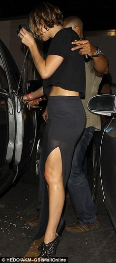 Flashing the flesh: The actress showed off her shapely legs in a tight skirt with thigh-high split