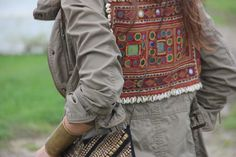 Military khaki, bright boho embroidery & seashells.