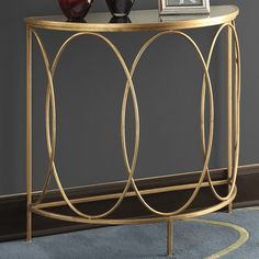 "29.87"" H x 31.87"" W x 13.87"" D $163:  -Gold leaf finish.  -Powder coated metal frame.  -Mirrored table top…"