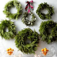 How about making a couple/few greenery wreaths or garlands with varied elements?  Cedar, ivy, eucalyptus, rosemary, preferred silver plant, white filler, queen anne's lace... Would nicely compliment mantel, white candles, and described house white lights... And not distract from band.