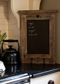 Gorgeous little rustic blackboard.  I have my eye on this for my kitchen... might help me keep track of things!
