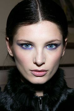 """Jason Wu  Using a bright purple shadow from Jason Wu's first collection with Lancome, makeup artist Diane Kendall gave models, """"vibrant, indigo eyes paired with muted cheeks and lips."""" She rimmed the eyes two violet liners—one kohl and one gel—before brushing on the shadow in diffuse cat-eye shape. Tons of black mascara finished the look."""
