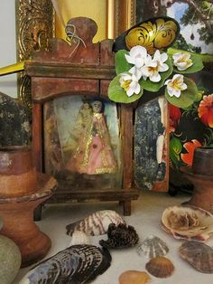 Lovely old Mexican altar interesting the items of the sea