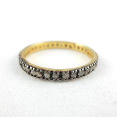 This eternity diamond ring features a single row of round champagne diamonds set in sterling silver (black and yellow rhodium plated). Perfect to wear on its own or to complement with other eternity rings in our stackable ring range.  Metal: Sterling Silver (Black and Yellow Rhodium Plated)  Gemstones: Champagne Diamonds  Diamond Total Weight: 0.54 ct  Total Weight: 1.28
