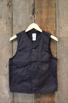 Buy him a Post Overalls Cruzer Vest made of Navy Cotton.