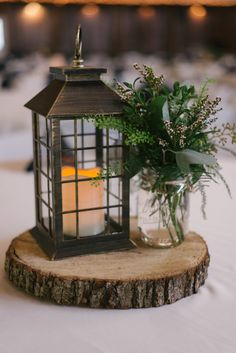 25 Elegant Greenery Wedding Table Decorations is part of Wedding lanterns We have gathered some of the most amazing wedding table décor ideas out here Today we share our favorite table setting ide - Lantern Centerpiece Wedding, Wedding Lanterns, Rustic Wedding Centerpieces, Centerpiece Flowers, Centerpiece Ideas, Wedding Rustic, Fall Wedding, Chic Wedding, Tree Stump Centerpiece