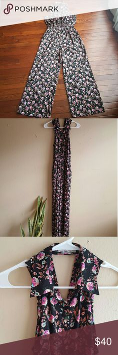 NWOT American Rag Black Floral Silky Jumpsuit NEW WITHOUT TAGS! Never worn!  Floral jumpsuit with silky fabric. Collar and elastic waist. Buttons run down the center to waist. Pockets on both sides. Criss-cross cut out design in back.  Will post measurements tonight. American Rag Pants Jumpsuits & Rompers