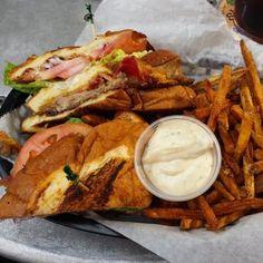 Image: Duck Club Sandwich  + Duck fat fries served with a housemade garlic aioili __The Tattooed Moose - Charleston SC :Americana Restaurant & Bar- Craft Beer Pub / Burgers / Sandwiches / *Duck confit & duck fat fries. Charleston, South Carolina