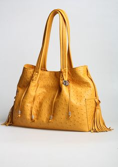 Beautiful Ntombi Ostrich leather bag. Via La Moda