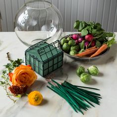 -Florist foam (open cage on both ends) -Carrots -Florist picks -Fishbowl -Floral arrangement Preparation:1. Fill sink with water, and soak florist foam until thoroughly saturated.2. Cut carrot stems to 2 inches.