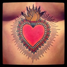 https://www.tattoodo.com/a/2015/05/15-intense-sacred-heart-tattoos/