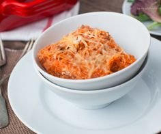 A baked spiralized spaghetti squash dish with cheese and tomato sauce