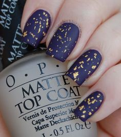 Matte navy blue and gold flake nails.