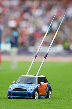 A remote control mini car returns the javelins on Tuesday, Aug. 7.