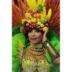 A member of Academicos do Salgueiro dances while wearing an elaborate headdress