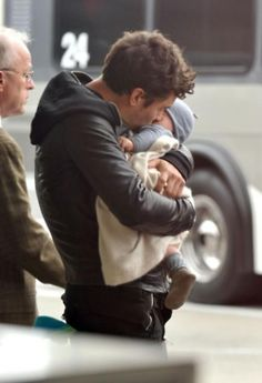 I don't know what it is about men holding babies that is so cute, but it is...