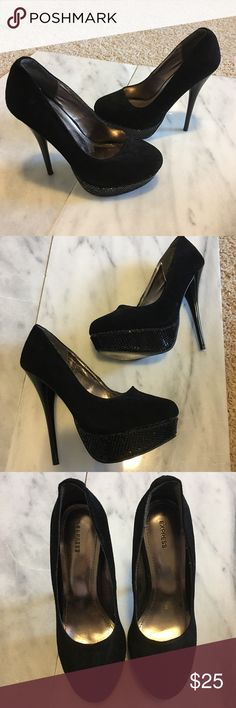 "GORGEOUS black Express pumps size 6.5 fits like 7 Gorgeous black 👠 stilettos! From Express marked a size 6.5 but fits more like 7 or even a small 7.5. Black faux suede on top with a stand out metal beading design on the platform. Such unique and gorgeous shoes. Just too big for me. 5"" heel and 1.5"" platform. Small scratches on the back of the left heel (see 5th pic). Not very noticeable at all. Cool silver metallic soles! Comes from a smoke free home. Express Shoes Platforms"