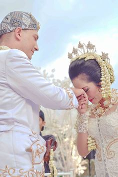 One of the respect and obey body sign as a wife to the husband in Traditional Sundanese Wedding Ceremony