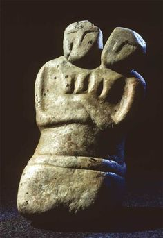 Sculpture of the Neolithic Age (6000 BC) depicting a couple embracing, from Catal Höyük. Ankara Museum of Anatolian Civilizations.
