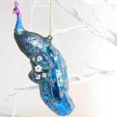 perching glitter peacock bauble by lisa angel homeware and gifts | notonthehighstreet.com