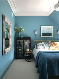 Blue bedroom walls in Polka Dot by Valspar U.K.  glass display cabinet using Annie Sloan graphite and black wax.