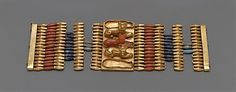 Date: ca. 1479–1425 B.C. Cuff Bracelets Decorated with Cats - New Kingdom Dynasty: Dynasty 18 Reign: Thutmose III Geography: Egypt, Upper Egypt; Thebes, Wadi Gabbanat el-Qurud, Tomb of the 3 Foreign Wives of Thutmose III, Wadi D, Tomb 1 Medium: Gold, carnelian, lapis-lazuli, turquoise glass. The Metropolitan Museum of Art -