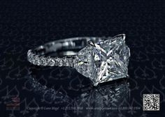 Princess diamond and two half moon diamond ring by Leon Megé.
